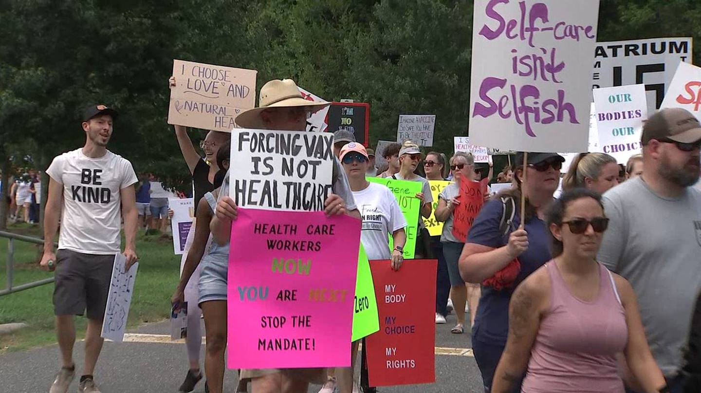 Hundreds of people gathered at Freedom Park in Charlotte to make their voices heard against Atrium and Novant Health's COVID-19 vaccine mandate for employees.