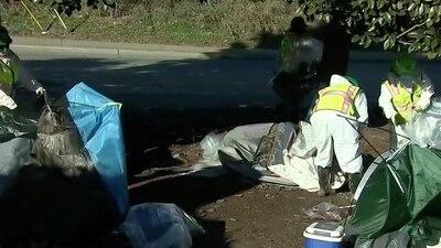 Crews begin clean up at homeless encampment near uptown