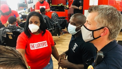 Cops and Barbers back to school bash