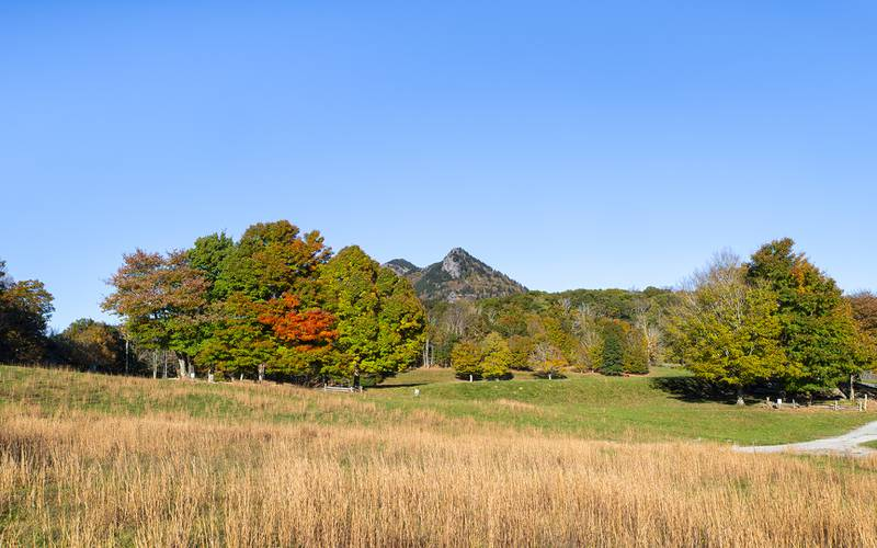 Grandfather Mountain's color-dappled peaks rise beyond MacRae Meadows, site of the annual Grandfather Mountain Highland Games.