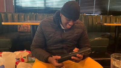 West Charlotte HS football player gets special surprise before Christmas