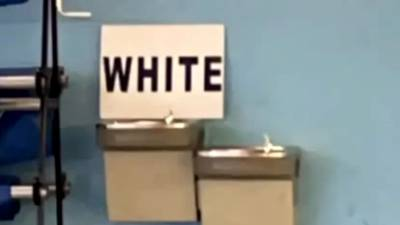 Sign mistakenly placed on water fountain at high school causes controversy