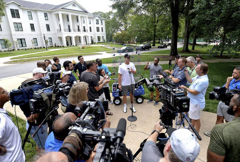Carolina Panthers quarterback Sam Darnold, center, speaks to the media at NFL football training camp, Tuesday, July 27, 2021, at Wofford College in Spartanburg, S.C.