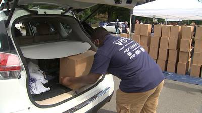 CMPD partners with local church, food bank to give out food to families in need