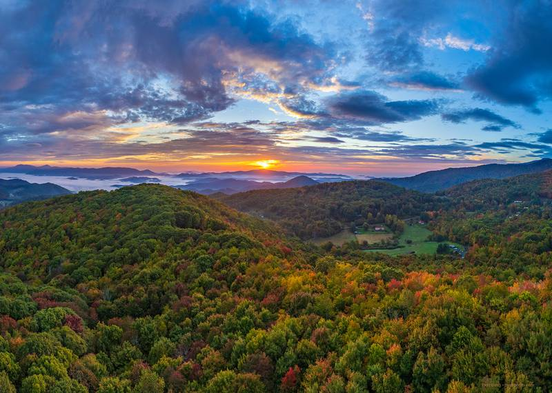 Sunrise cascades over the WNC High Country, highlighting bursts of fall color appearing in the area's lower elevations, as seen from the town of Banner Elk this past Sunday.