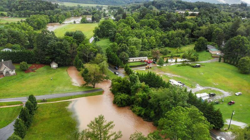 AUGUST 18, 2021 - Pigeon River, bridge washed out and road underwater in the Beaverdam Community in Canton. (Photo credit: Suzie Pressley)