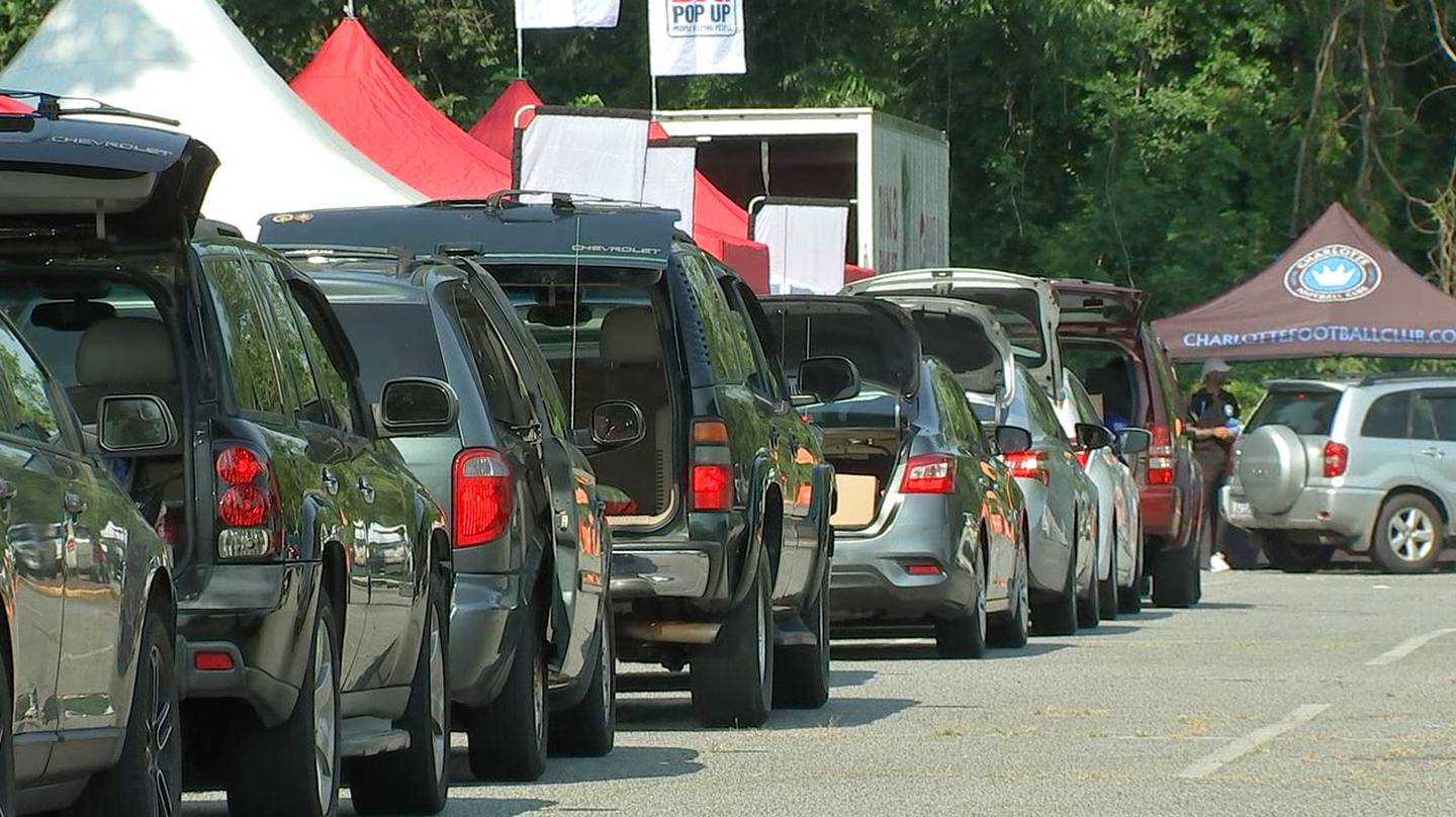 Hundreds of people showed up for a huge food and household supplies giveaway Thursday in east Charlotte.
