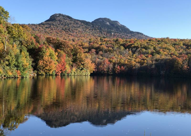Fall color cascades down the lower slopes of Grandfather Mountain to the shores of nearby Grandfather Lake. This past weekend saw peak color throughout much of the WNC High Country, and experts anticipate elevations above 2,500 feet to follow suit this week.