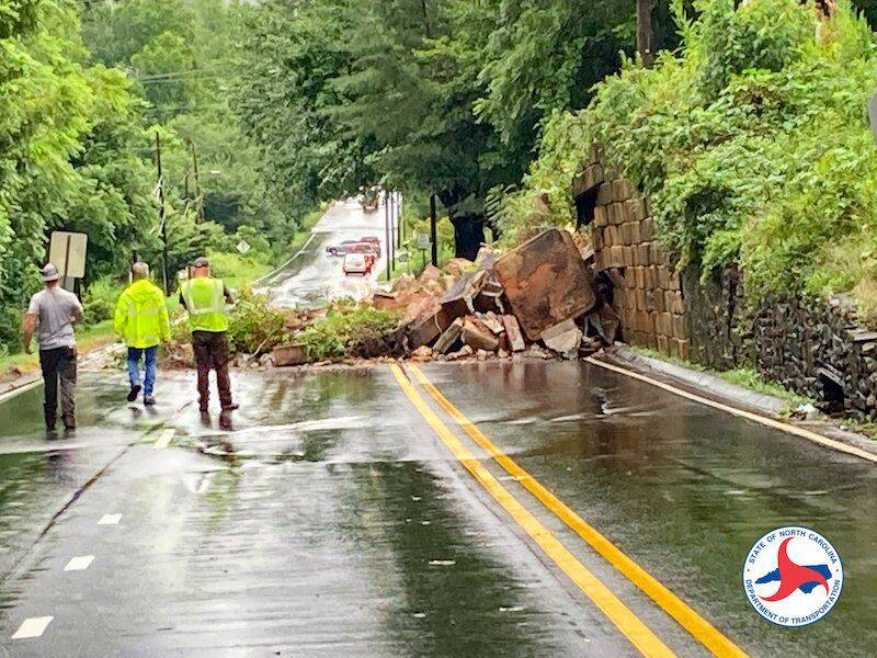 AUGUST 17, 2021 - A collapsed rock retaining wall near Church Street in Canton has closed both directions of U.S. 19/23 in Haywood County. (Photo credit: NCDOT)
