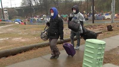 Tent City residents must clear out by 5 p.m. today; Many shuttled to hotel